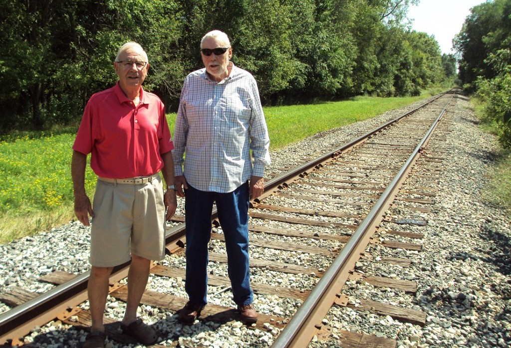 McNamara, left, and Nelson stand on the railroad tracks that divided the five western opening holes at Valley View from its four eastern closing holes.