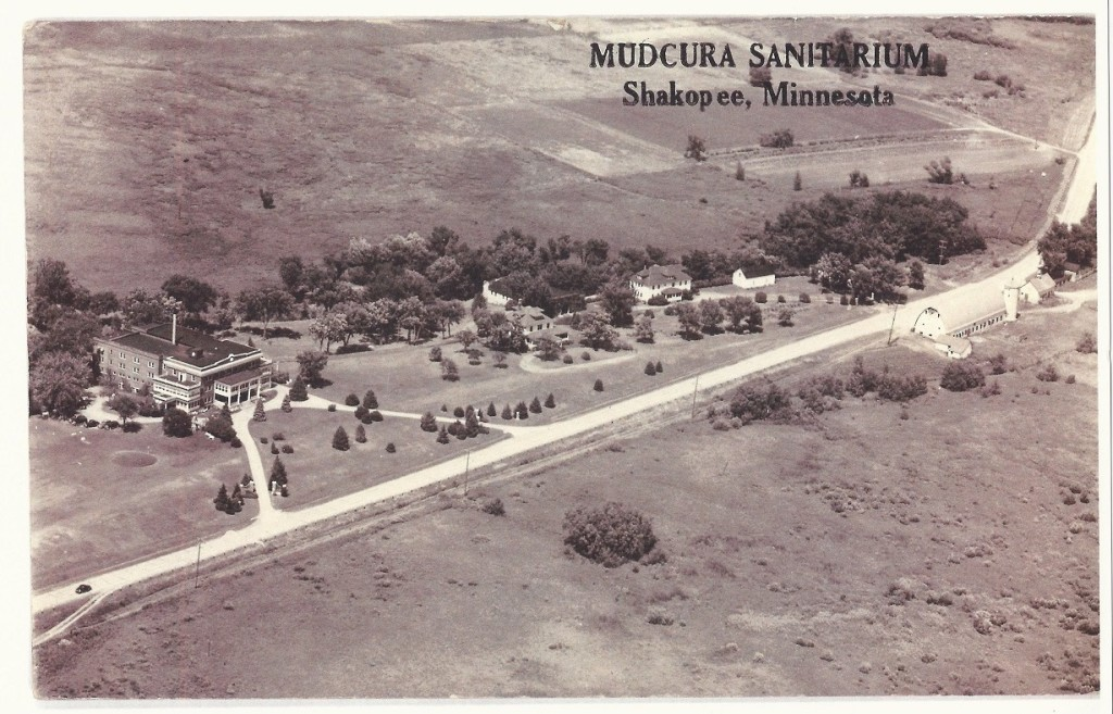 Mudcura Sanitarium. The road in front of the sanitarium is what is now Flying Cloud Drive. The oval-shaped feature near the left edge of the photo and close to the edge of the sanitarium was almost certainly a green on Mudcura Golf Club.