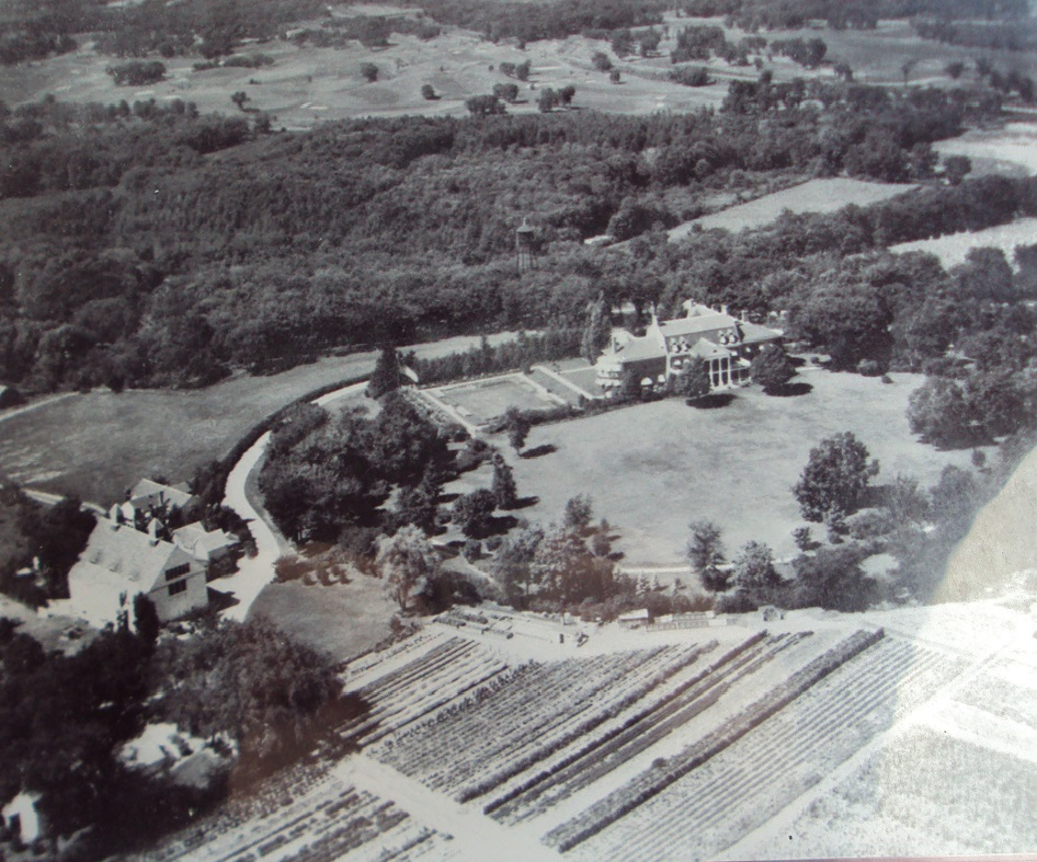 Historic aerial photo of the Highcroft estate founded by grain magnate F.H. Peavey in Wayzata. Photo courtesy Keith Schafer. I believe the relatively open area at the top of the photo is part of Woodhill Country Club. The open area near the mansion is the south side of Highcroft, with farm buildings to the left (west). The Ferndale practice golf course likely had its first tee near the right or bottom-right part of the photo.